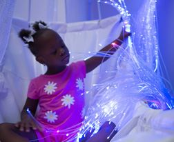 Girl with Fiber Optics in the therapeutic sensory room
