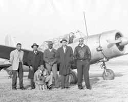 columbia air center pilots standing in front of crop duster (sepia color)