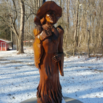 Wood carving of the fictional Witch of Watkins Park